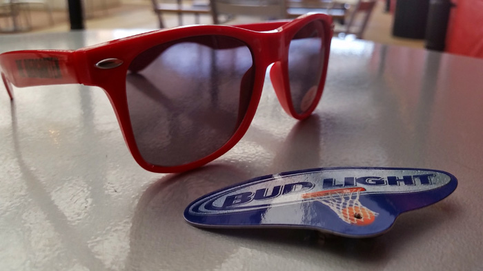 Glasses and a pin that were given out to celebrate the first Sunday Funday!! brunch at The Biergarten at Anhesuer-Busch