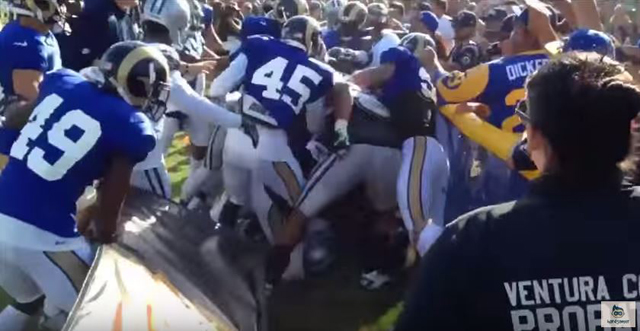 The St. Louis Rams and Dallas Cowboys fight at a recent joint practice.