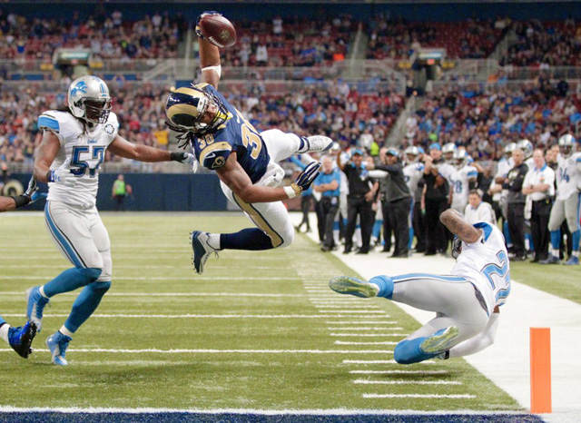 Todd Gurley leaps for a touchdown against the Detroit Lions. Credit: St. Louis Rams