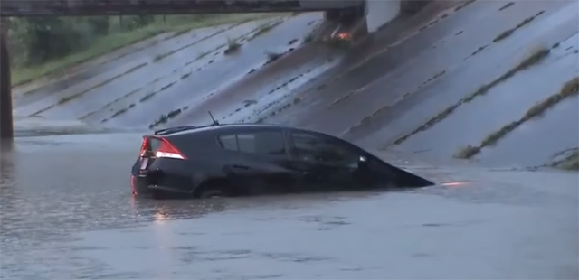 Houston reporter helps rescue man from this Prius that was stuck in Houston flood waters