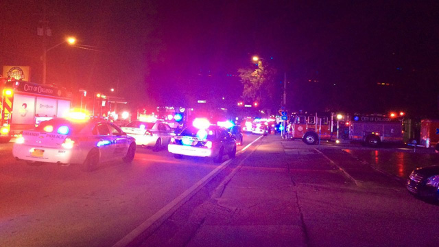 Police vehicles responding to news of a mass shooting and hostage situation at Pulse in Orlando.