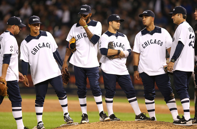 Chicago White Sox players wearing the 1976 throwback jerseys Chris Sale protested against.