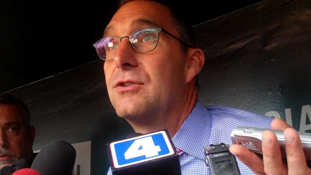 St. Louis Cardinals GM John Mozeliak taks to reporters about a former St. Louis Cardinals staffer