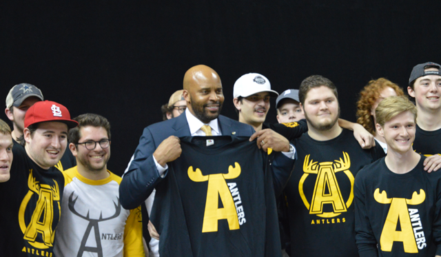 New Missouri men's basketball coach Cuonzo Martin poses with legendary student group The Antlers after his introductory press conference on March 20, 2017.