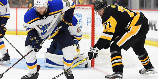 Alex Pietrangelo of the St. Louis Blues and Evgeni Malkin of the Pittsburgh Penguins battle for the puck during an NHL game between the teams. Credit: NHL