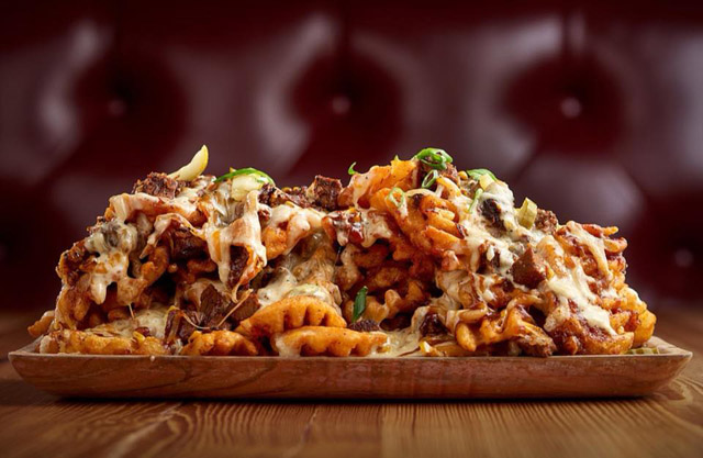 Smothered Brisket Fries at Rascal Flatts Restaurant in Stamford, Connecticut. The group has plans to open a location in downtown St. Louis. (Credit? Rascal Flatts Stamford Facebook)